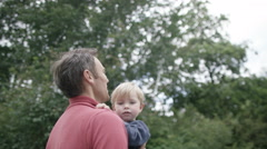 4K Happy affectionate father and son spending time together outdoors - stock footage