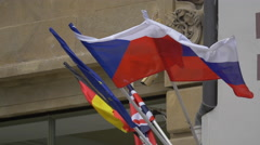 Five flags waving on building in Prague Stock Footage