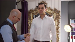 4K Client being measured by tailor for a custom made suit. - stock footage