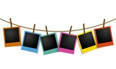 Empty colorful photo frames hanging on rope with pin Stock Illustration