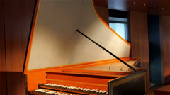 An old grand piano inside a room Stock Footage