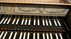 The beautiful old grand piano in a room Stock Footage
