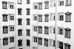Detail facade of black white building with windows and balcony Stock Photos