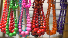 Necklaces hanging on a wire fence in Prague - stock footage