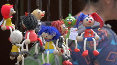 Little puppets hanging from a souvenir stalls in Prague Stock Footage