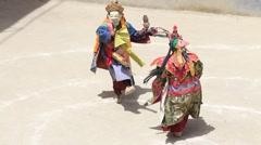 Tibetan lamas in mystical mask perform ritual dance. Lamayuru, Ladakh, India Stock Footage