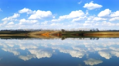 Clouds are reflected in smooth water of lake, 4k Stock Footage