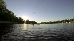 The guy doing tricks on a wakeboard in slow motion on the lake Stock Footage