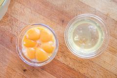 Egg yolks and whites - stock photo