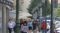 People walking on a street with old lamp posts in Prague Stock Footage