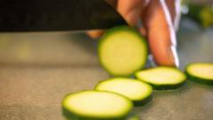 Organic Zucchini being Sliced Extreme Close Up - stock footage