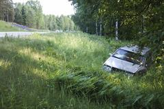 Car accident off the road - stock photo