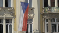 Czech flag hanging on an old building in Prague Stock Footage