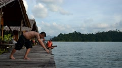 Thai people play and jumping to lake water at Khao Sok National Park Stock Footage