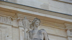A statue of a woman outside the castle of Versaille - stock footage