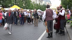 Stock Video Footage of citizen people enjoy charismatic folklore band performance at street. 4K