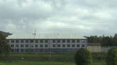 The building and nearby detention camp for refugees in Vysni Lhoty Stock Footage