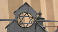 Close up view of the Star of David symbol on Cervena Street in Prague Stock Footage