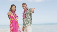Aloha couple on Hawaiian beach - Hawaii vacations concept - stock footage