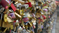 The love locks locked on the bridge - stock footage