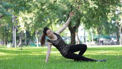 Portrait of thai adult beautiful girl doing yoga exercises in the park Stock Footage