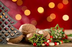 Christmas tree with wallnuts and decorations Stock Photos