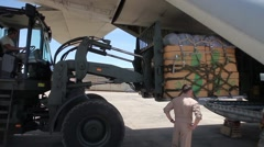Thailand, May 2015, US Air Force Stacker Load Cargo In C17 Aircraft - stock footage