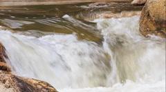 Closeup panorama of rough water flow of mountain stream Stock Footage