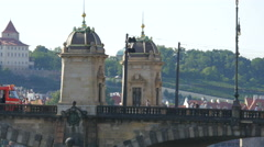 Trams crossing Legion Bridge in Prague Stock Footage
