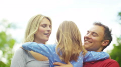 4K Happy & affectionate parents with young daughter spending time together outdo - stock footage