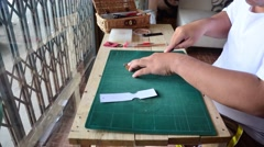 Thai man making leather keyring product handmade. Stock Footage