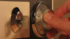 A Hand Opening A Combination Lock On Safe Stock Footage