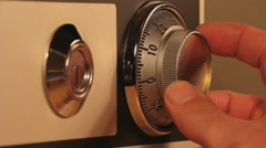 Stock Video Footage of A Hand Opening A Combination Lock On Safe
