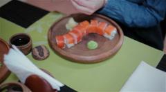 Two girls eating sushi Stock Footage