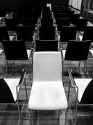 White chair turned into other direction - non-conformist - stock photo
