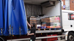 Lorry driver closes the covers Stock Footage