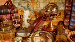 Vintage magnifying glass lies on an ancient world map Stock Footage