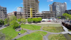 A rising shot from a downtown park reveals central business district of Portland Stock Footage