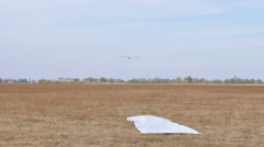 Glider  land on  soil field and open  airbrake.  Stock Footage