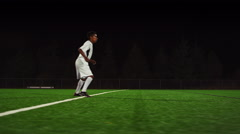 The camera pans with a soccer team as they score a goal, in slow motion Stock Footage
