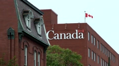 Canada Newfoundland St. John's 001 writing on house wall and national flag Stock Footage