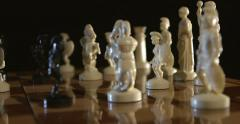 Chess pieces on chessboard Stock Footage