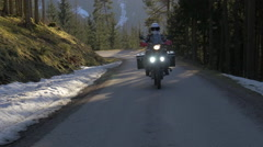 Motorbike rider riding his enduro in early Spring Stock Footage