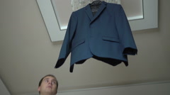 The Groom Takes His Jacket Off The Hanger Stock Footage