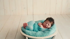 Cute newborn baby sleeping on a blanket - stock footage