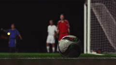 Close up of a corner kick during a soccer game at night - stock footage