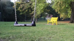 Stock Video Footage of Empty swing on children playground in the park