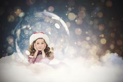 Composite image of festive child in snow globe Stock Photos