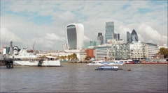 River Thames with City skyscrapers and HMS Belfast, London, UK Stock Footage