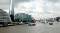 River Thames pan from City Hall and The Shard to the City of London skyscrapers Stock Footage